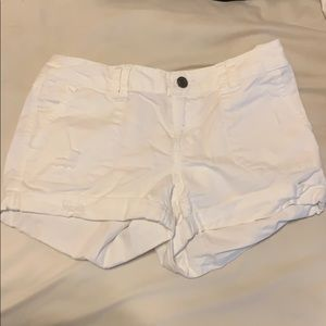 mossimo white mid rise shorts with rips